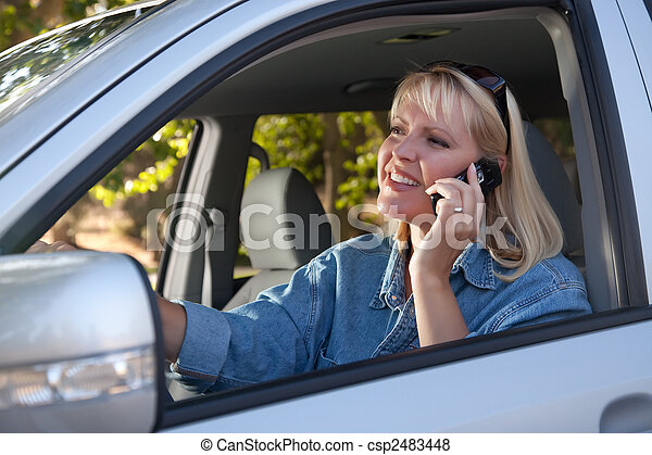 Attractive Woman Using Cell Phone While Driving - csp2483448