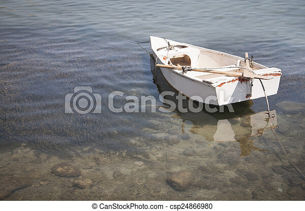 Old white row boat