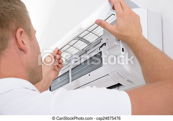 Man Adjusting Air Conditioning System