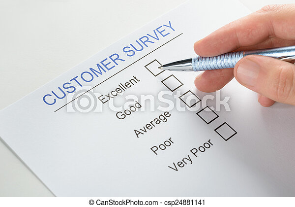 Person Hand With Pen Over Customer Survey Form
