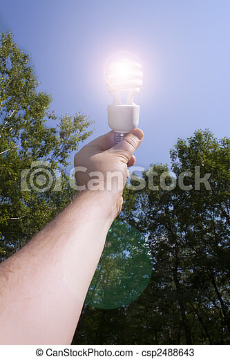 Energy saving light bulb lit outside - csp2488643