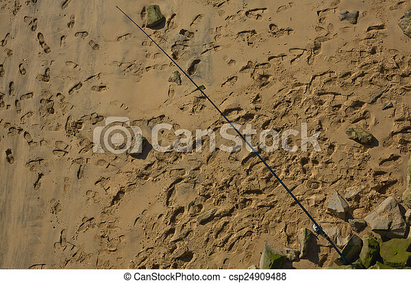 Pictures of fishing rod standing on spanish beach huelva for Fishing rod in spanish