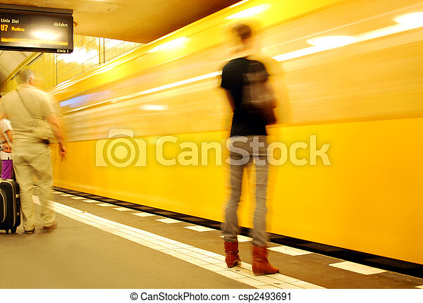 young woman waiting for the orange berlin metro train - csp2493691