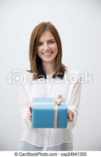 Portrait of a happy woman giving gift on camera