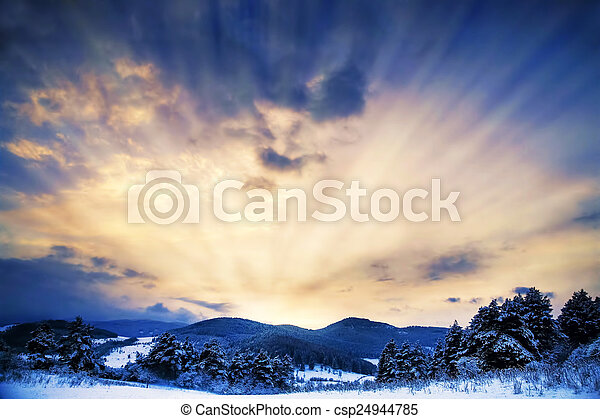 Winter Landscape with Sun Rays and Dramatic Sky