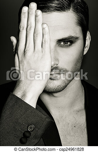 Man covering his right eye with her hand