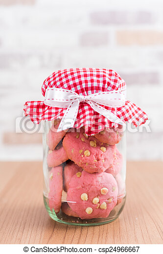 Strawberry cookies in glass canister, cap with plaid fabric