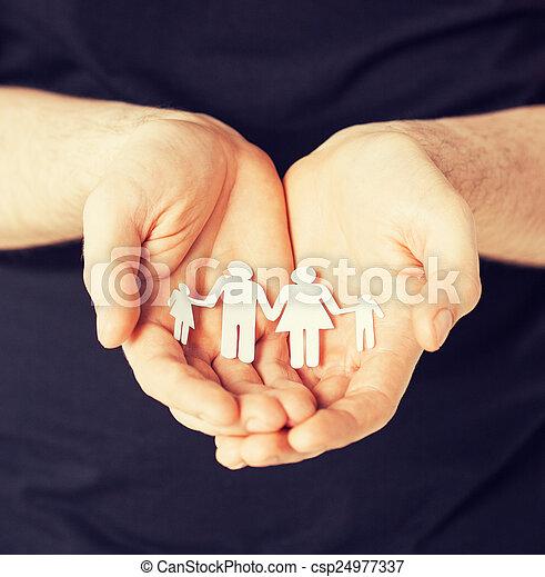 man hands with paper men - csp24977337