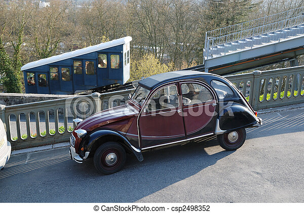 Old automobile tuning against funicular in spring park. - csp2498352
