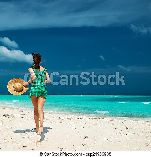 Woman in green dress at beach