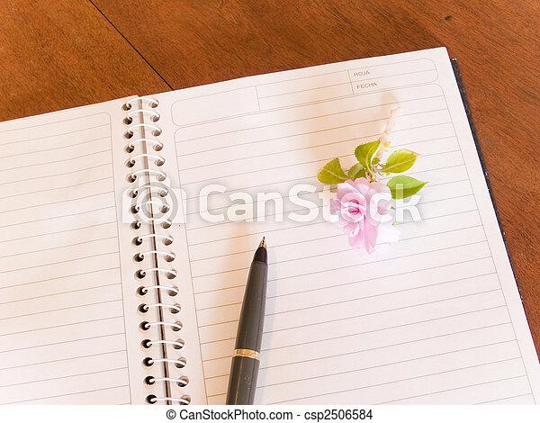 notebook, pen, and flower - csp2506584
