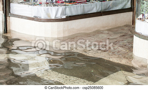 Entrance of a store during high water in Venice.