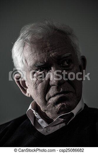 Old depressed man crying