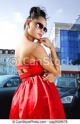 independent brunette in sunglasses - csp2509578