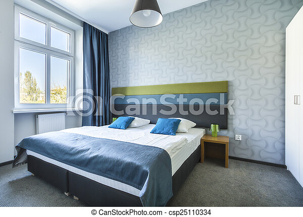 Big twin bed in blue hotel apartment - csp25110334