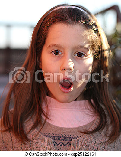 girl surprised with a wool sweater outdoors