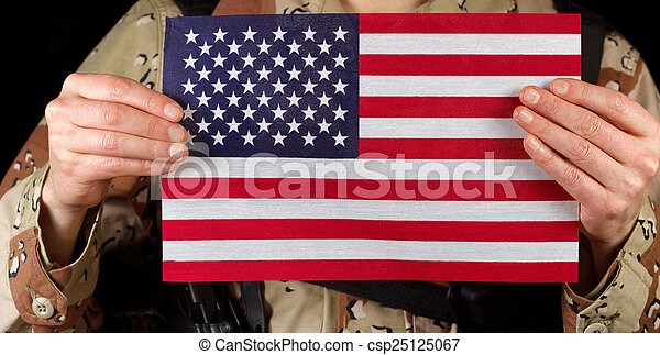 American flag being held by male soldier  - csp25125067