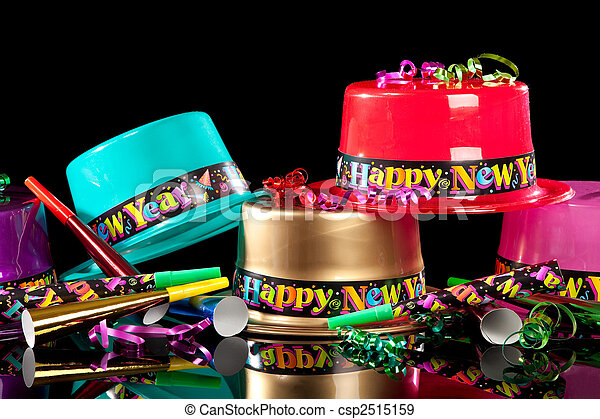 New Years' Eve party hats on  black background - csp2515159