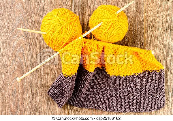 yarn, knitting needles and scarf
