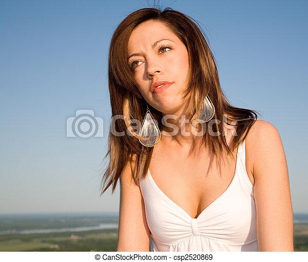 Beautiful Brunet Portrait Under a Blue Sky - csp2520869
