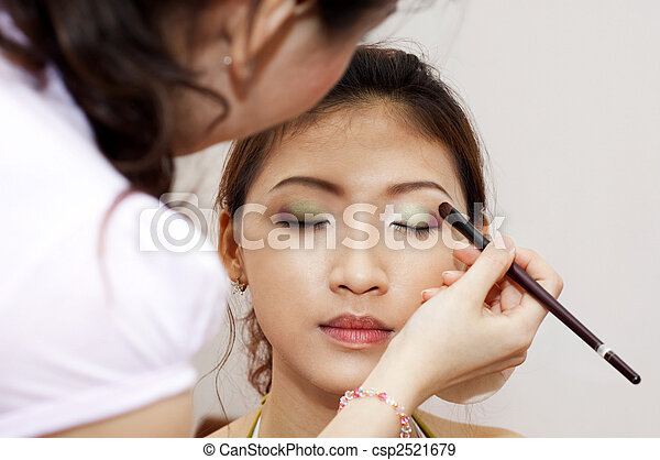 Applying makeup. - csp2521679