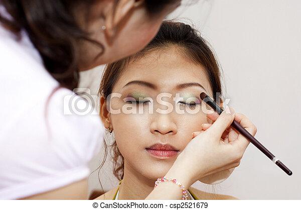 Applying makeup. - csp2521679