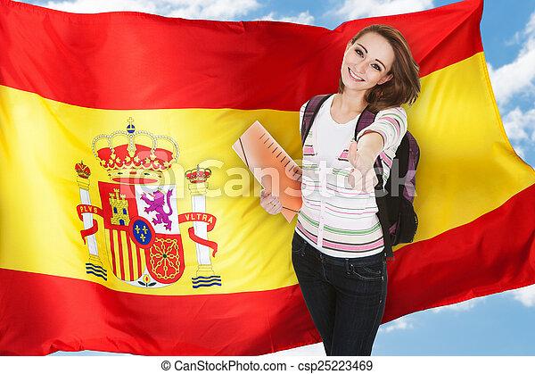 Spanish Student Gesturing Thumb Up