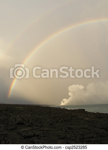 Rainbow over lava flow - csp2523285
