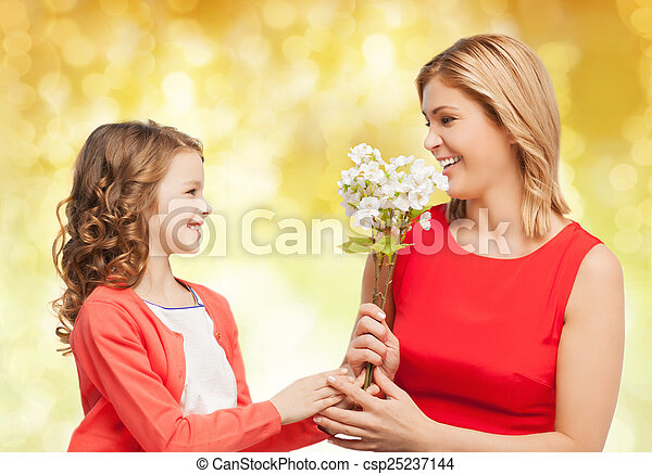 happy little daughter giving flowers to her mother - csp25237144