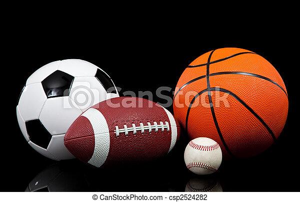 Sports balls on a black background - csp2524282