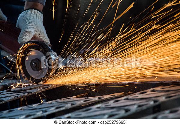 Worker are cutting steel for repair old door