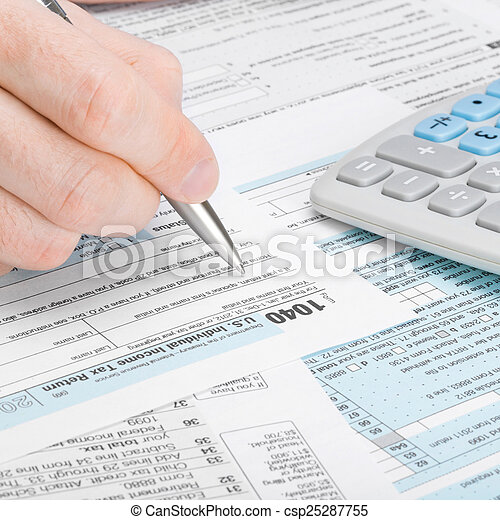 Man filling out 1040 tax form