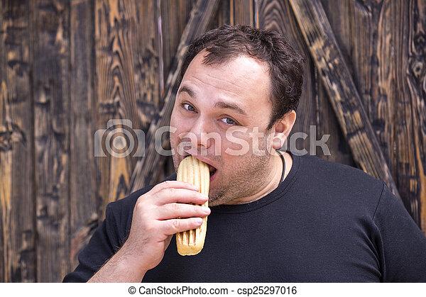 man eating a hot dog - csp25297016