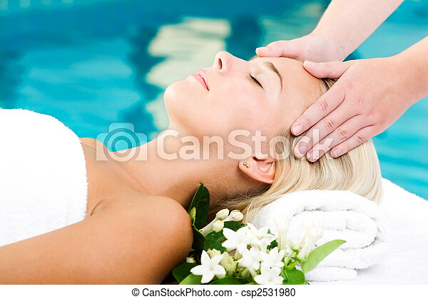 Beautiful young woman getting a spa treatment - csp2531980