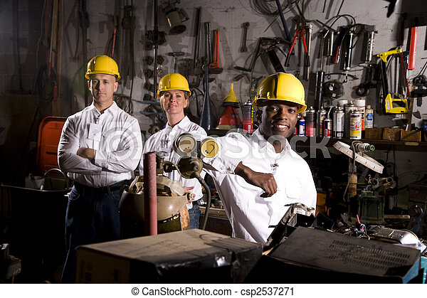 Colleagues in office maintenance area - csp2537271