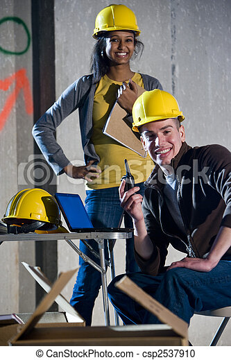 Multi-ethnic male and female construction workers - csp2537910