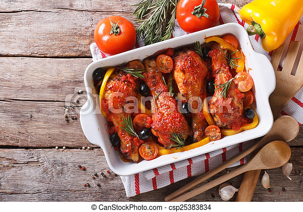 Chicken legs baked in tomato sauce horizontal top view