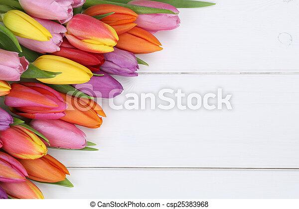 Tulips flowers on wooden board