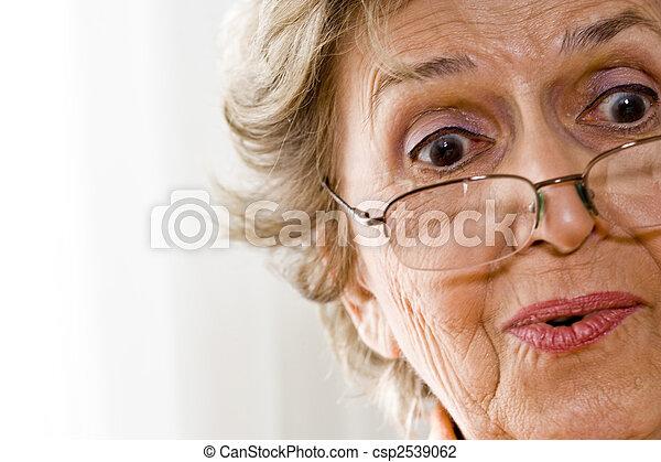 Elderly woman wearing reading glasses - csp2539062