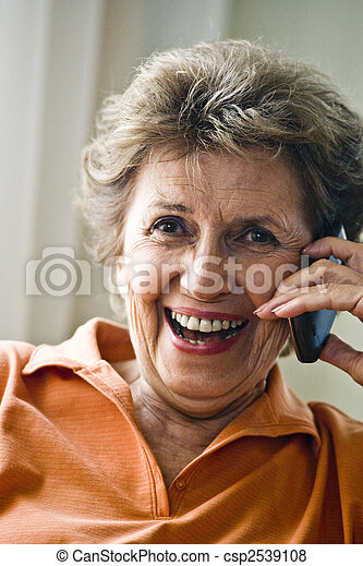 Close up of happy elderly woman on mobile phone - csp2539108