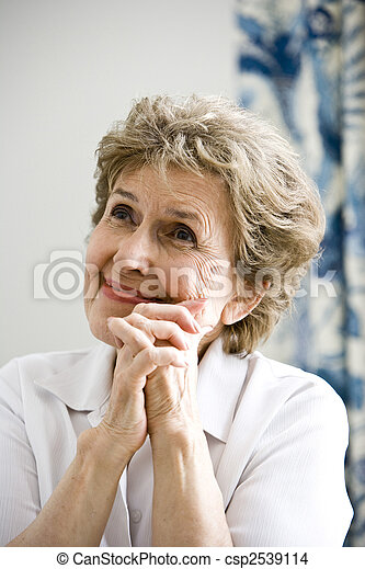 Close up of elderly woman thinking happy thoughts - csp2539114