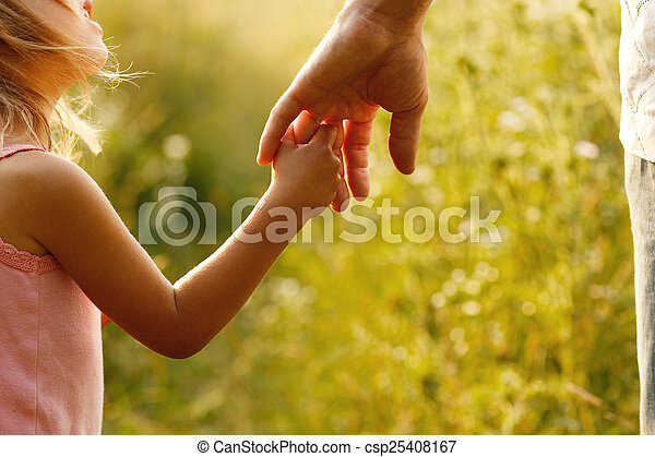 parent holds the hand of a small child - csp25408167