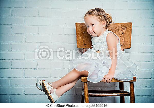 sitting on chair - csp25409916