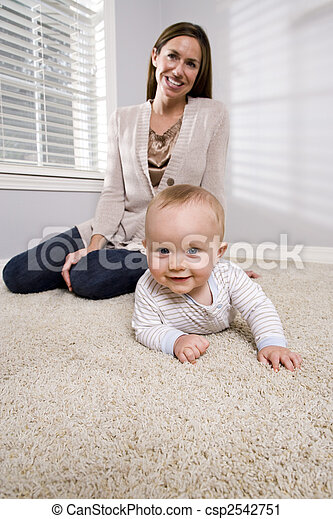 Mother with baby learning to crawl - csp2542751