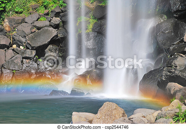 Majestic waterfall with colorful rainbow - csp2544746