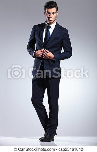 young business man closing his jacket