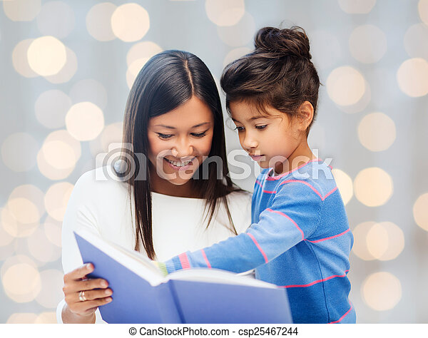 happy mother and daughter reading book