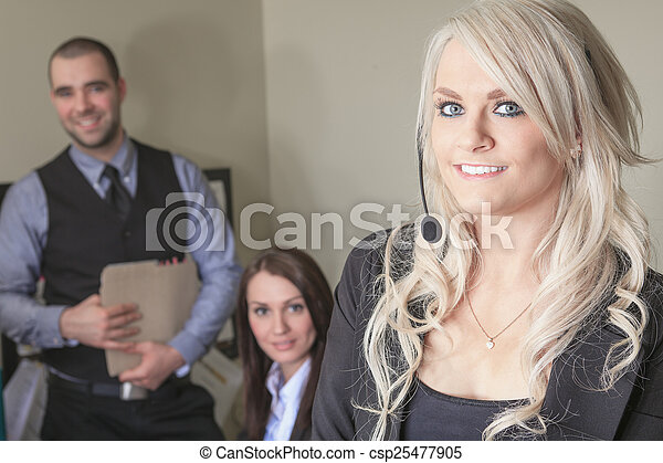 Image of business partners discussing documents and ideas at off