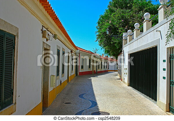 A narrow street in Lisbon, Portugal - csp2548209