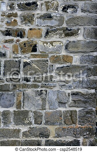 Antique grunge old gray stone wall masonry - csp2548519